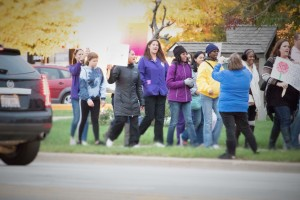 Supporters march down Plainfield Road and Hennepin Street following the gathering and vigil