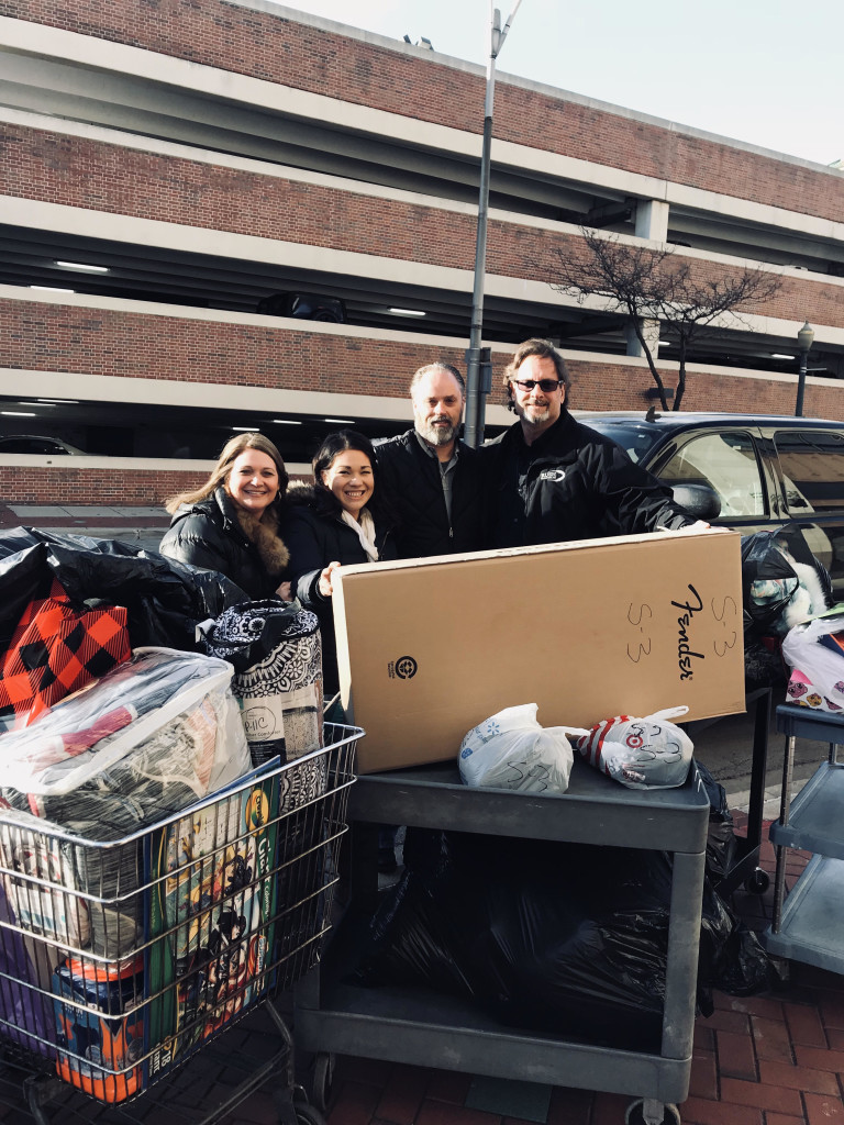 "Rush Transport delivers a very generous collection of ""Angels on Assignment"" gifts for GACS clients. Rush employees shopped for specific children and families who submitted ""Angels on Assignment Wish Lists"" and delivered everything that was asked for + more, including a Fender guitar for one very lucky boy."